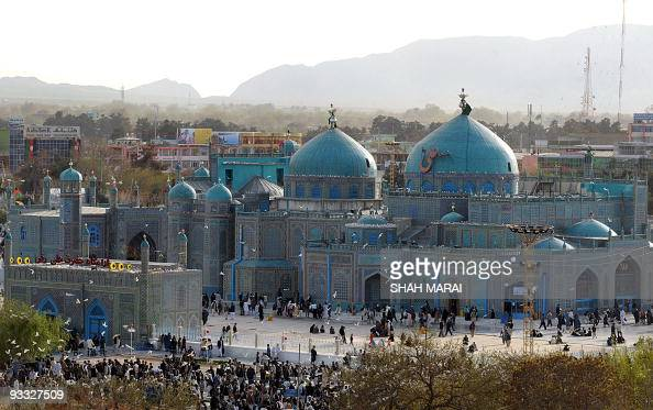 Afghans walk at the Hazrat Ali Shrine in the northern town of MazariSharif in Balkh province on March 19 2009 Tens of thousands of Afghans from all...