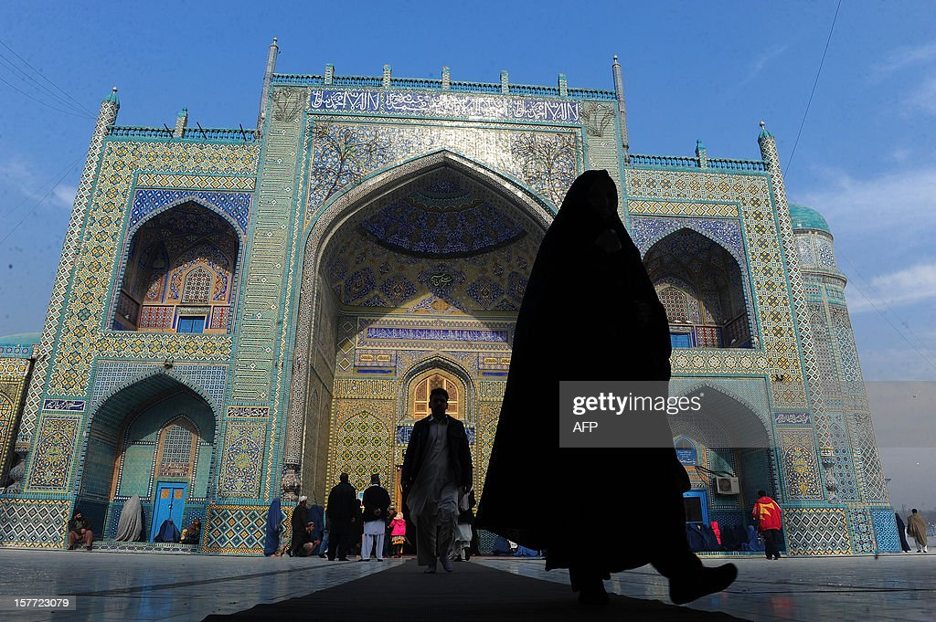 Afghans walks at the Ali Shrine in the northern town of Mazar-i-Sharif in Balkh province on December 6, 2012. Once known as the 'mother of cities,' the ancient city of Balkh was a popular destination along the ancient Silk Route. Balkh was destroyed by Mongol conqueror Genghis Khan during his rule, with the city's ruins remaining as a tourist attraction today. AFP PHOTO/ Qais Usyan
