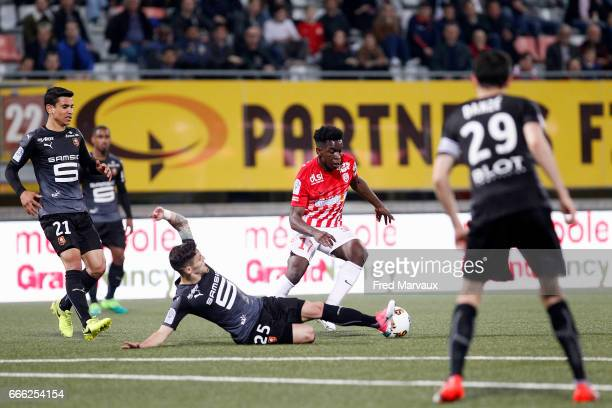 Afonso Figueiredo of Rennes and Faitout Maouassa of Nancy during the Ligue 1 match between As Nancy Lorraine and Stade Rennais at Stade Marcel Picot...