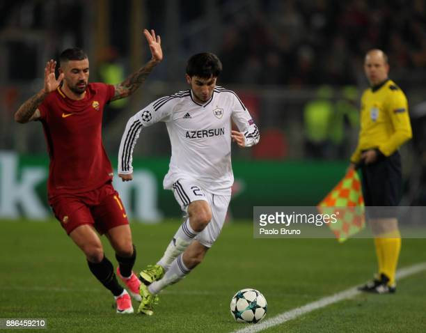 Afran Ismayilov of Qarabag FK competes for the ball with Aleksandar Kolarov of AS Roma during the UEFA Champions League group C match between AS Roma...