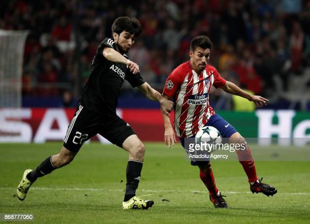 Afran Ismayilov of Qarabag FK in action against Nico Gaitan of Atletico Madrid during the UEFA Champions League Group C soccer match between Atletico...