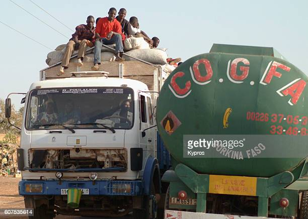 Africa, Burkina Faso, View Of African Taxi With People Sitting On Roof (Year 2007)
