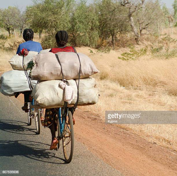 Africa, Burkina Faso, View Of People Riding Bicycles (Year 2007)