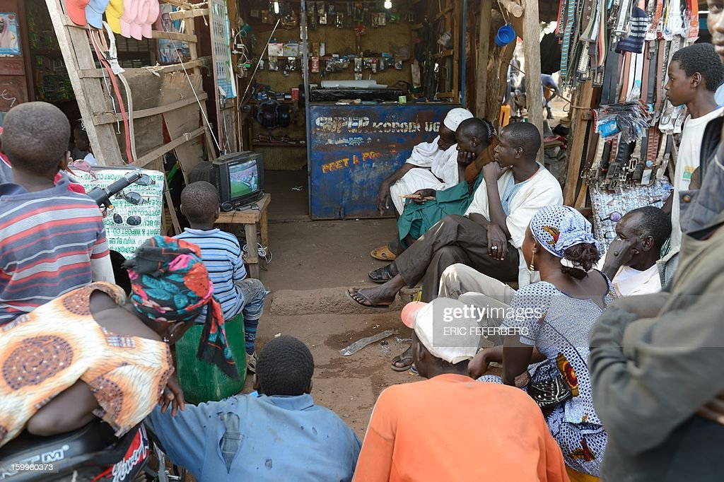 Africa Cup of Nations football match Ghana vs Mali in a shop of Segou on January 24,2013.