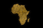 Africa shaped from golden glitter on a black background (series)