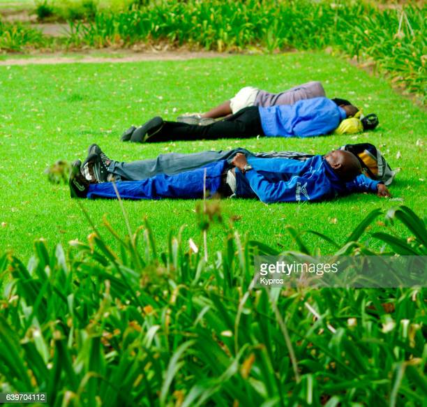 Africa, South Africa, Cape Town, View Of Workers Sleeping On Lawn At Company's Garden Park (Year 2009)