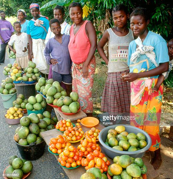 Africa, Southern Africa, Mozambique, View Of Working Women Selling fresh Fruit At Village Market. Food (And Fuel) Was Difficult To Find, And This Was The First Available (After About A Week Of Driving). Civil War Had Recently Ended, And Soldiers Used The