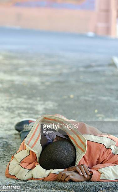 Africa, Southern Africa, South Africa, Cape Town, View Of Homeless African Teenager Sleeping In Street (Year 2009)