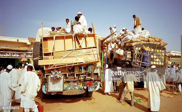 Africa, Sudan, North Sudan, Khartoum, View Of Overloaded Taxi Or Bus With Passengers On Roof (2000)