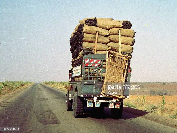 Africa, Sudan, Sahara Desert, View Of Truck Carrying Sacks Of Charcoal (Year 2000)