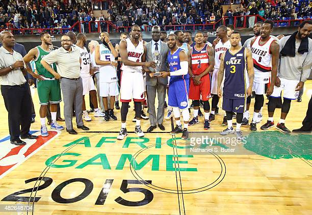 Africa Vice President Managing Director Amadou Gallo Fall presents Captain Luol Deng of Team Africa and Captain Chris Paul of Team World the MVP...