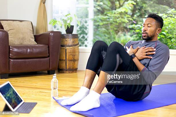 African American adult male doing a core workout