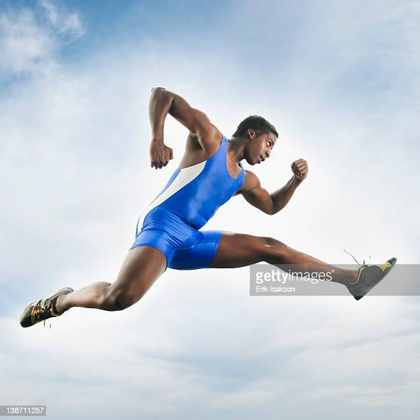 African American athlete jumping in mid-air