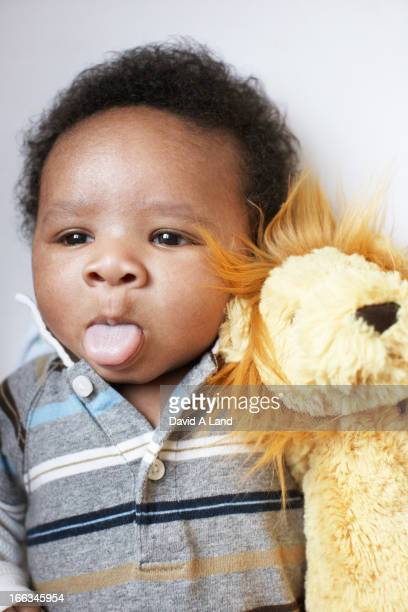 African American baby sticking out tongue