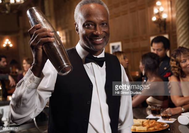 African American bartender mixing cocktails