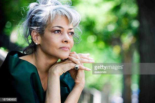 African American Beautiful Senior Woman Sitting Outdoors, Copy Space