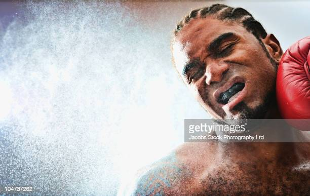 African American boxer getting hit