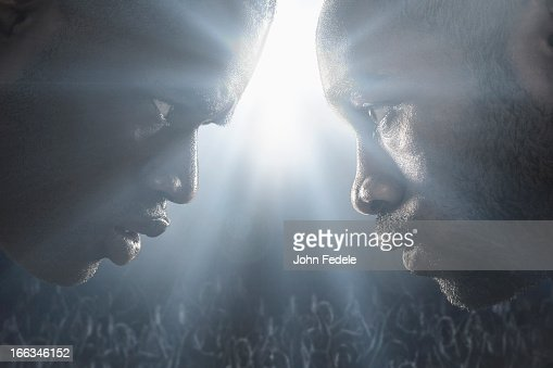 African American boxers standing face to face