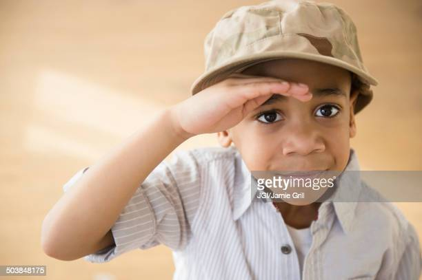 African American boy giving salute
