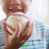 African American boy holding baseball