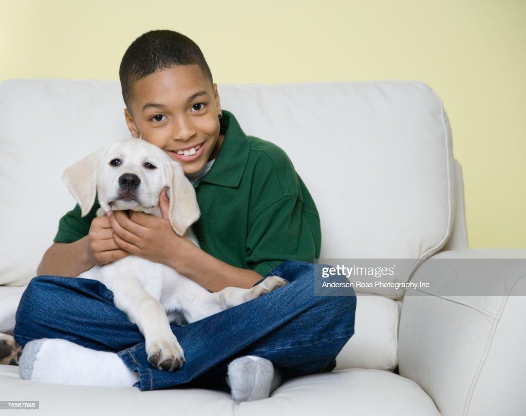 African American boy hugging dog : Stock Photo