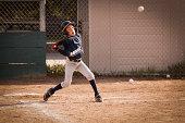 African American boy playing baseball