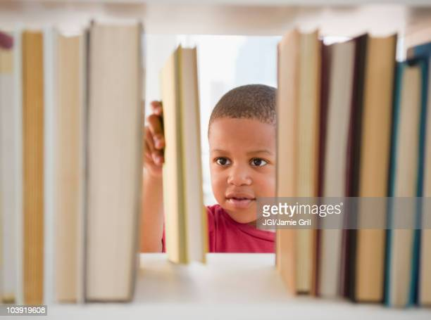 African American boy selecting book