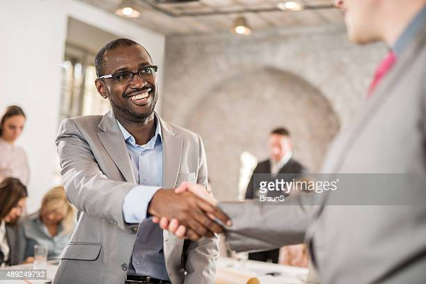 African American businessman come to an agreement with his colleague.