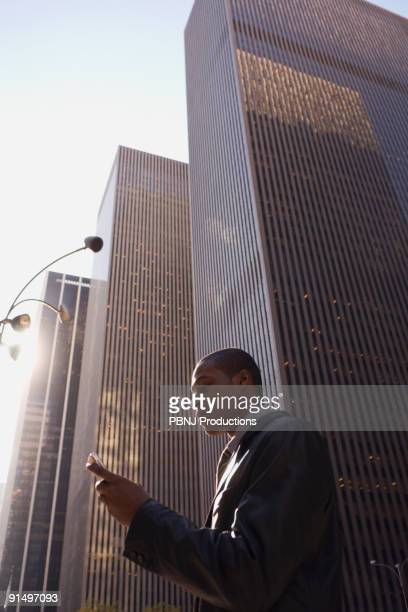 African American businessman looking at cell phone