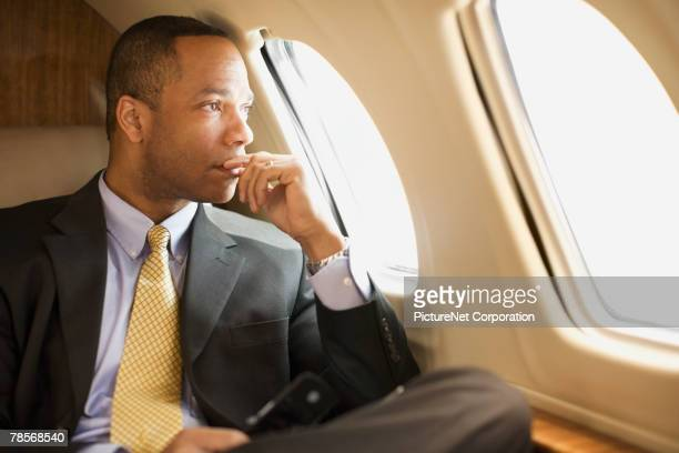 African American businessman on airplane