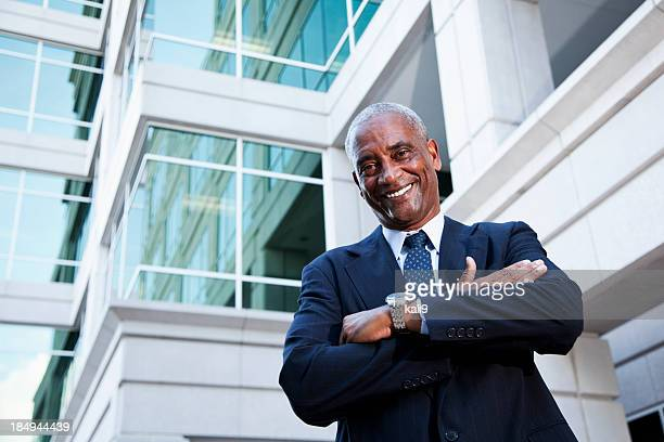 African American businessman outside office building