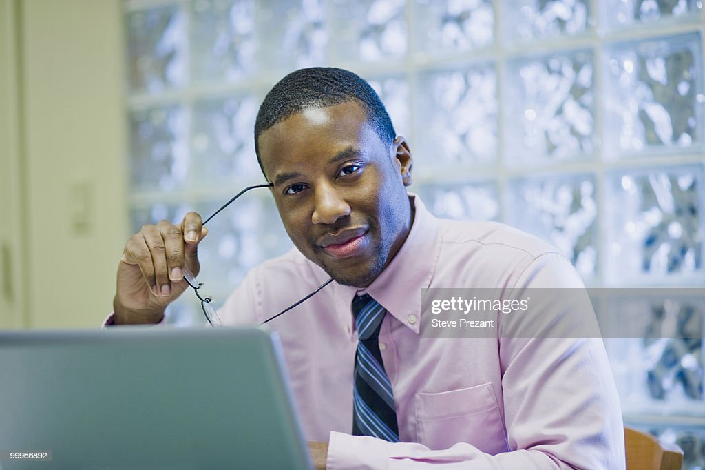 African American businessman sitting at desk