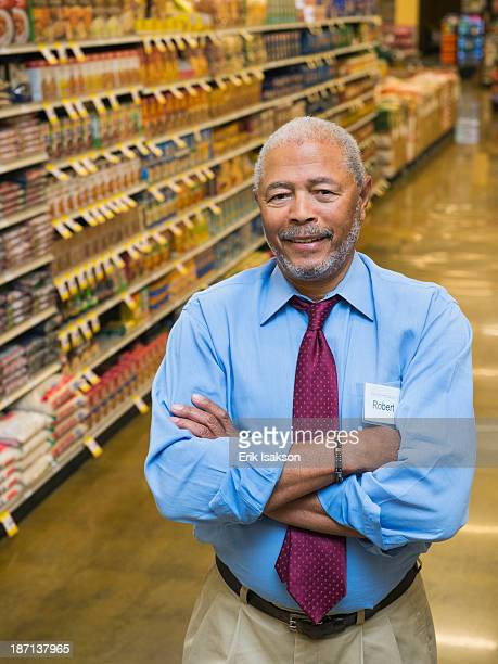African American businessman smiling in grocery store