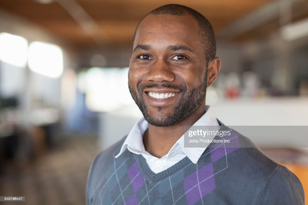 African American businessman smiling in office