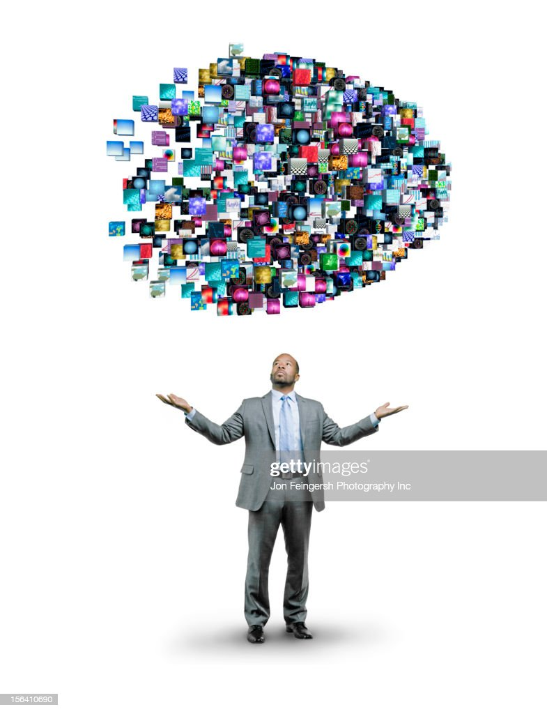 African American businessman underneath cloud of technology images : Stock Photo