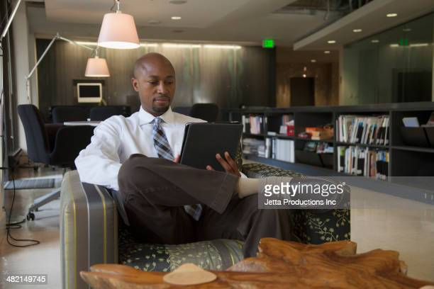 African American businessman using digital tablet