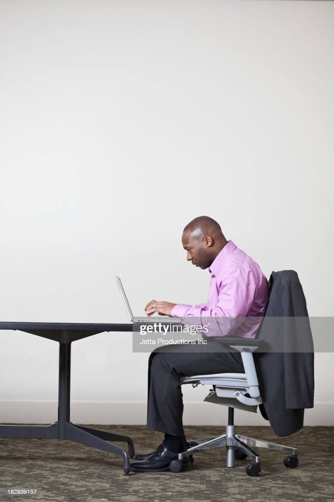 African American businessman using laptop : Stock Photo