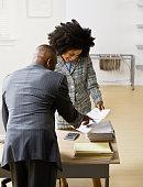 African American businesspeople looking at paperwork