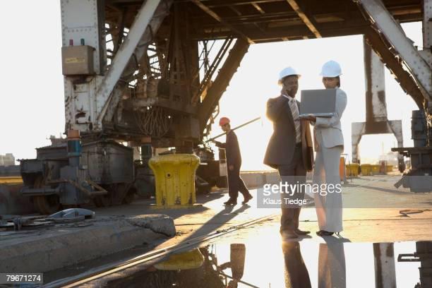 African American businesspeople wearing hardhats