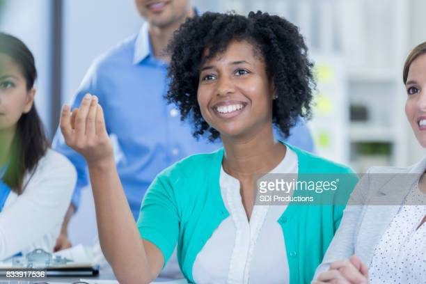 African American businesswoman asks question during seminar