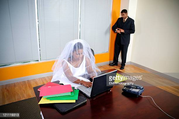 African American Businesswoman Bride Working White Groom Stands By