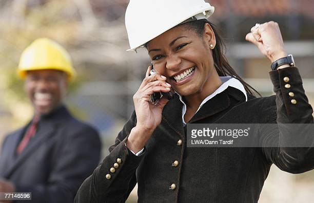 African American businesswoman cheering on cell phone