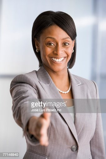 African American businesswoman extending hand to shake : Stock Photo