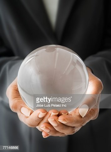 African American businesswoman holding crystal ball : Stock Photo
