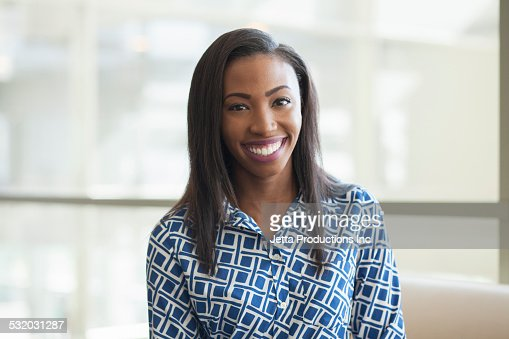 African American businesswoman smiling in office