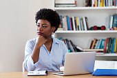 African american businesswoman with depression at office at home