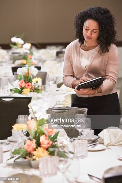African American businesswoman working in dining room