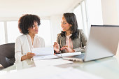 African American businesswomen talking in meeting