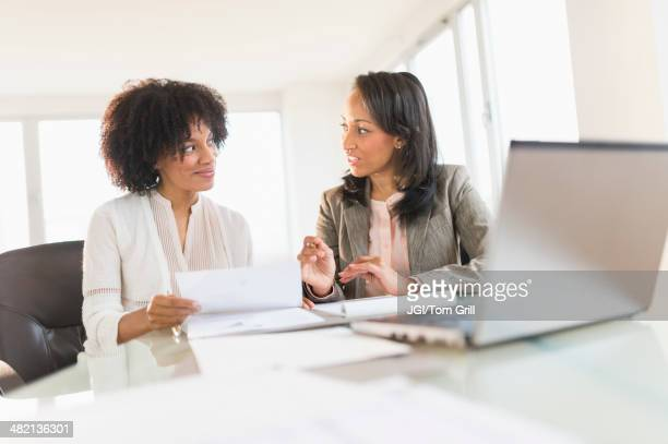 African American businesswomen talking in meeting
