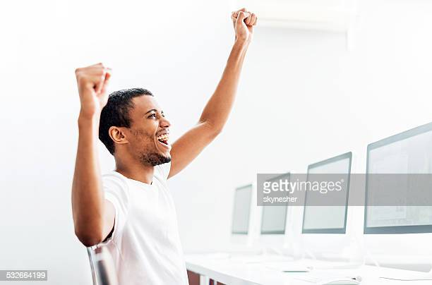 African American celebrating in a computer lab.